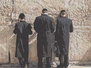 Praying fervently at the Western Wall Kotel