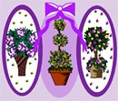 A trio of topiaries garnished with ribbons in lilac colors.
