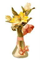 A crystal vase containing pretty flowers, decorating nicely with a ribbon and bow.